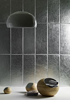 Metallic leather wall tile by Cuir au Carre. Hot.