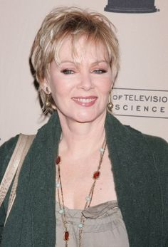 The perfect cut for fine hair: a spunky layered shag with bangs like Jean Smart wears.