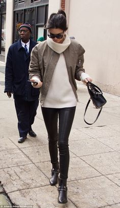 Model style: Kendall, 19, wore leather-look leggings, a cream jumper and a khaki jacket...