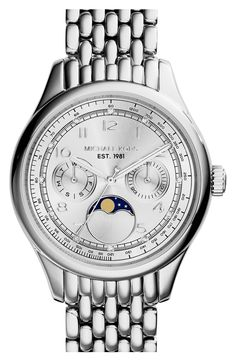Currently wearing this stunning silver Michael Kors watch.