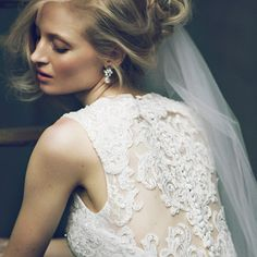 Take a closer look at the gorgeous lace back of Oleg Cassini Style CWG667.