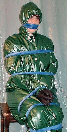 Bondage in plastic rainwear