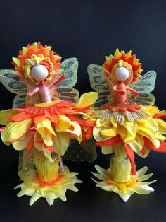 These are a group of dolls depicting the Sun, Moon and Stars. These Sun Fairies are dress is designed with Orange and yellow Felt and Flowers. There are layered to look like sun rays. The felt material specially cut like sun rays and flowers chosen with very narrow petals. Her headdress