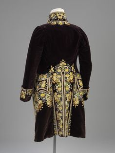 However, the requirements of court dress kept alive the textile and embroidery industries of the 18th century. The embroidery for the coat and waistcoat were done first, in the areas where it was required for the finished garment. Although made of different fabrics the coat and waistcoat share the same embroidery design. They would have been sold together by a silk mercer, then taken to the tailor to be made to fit the purchaser.