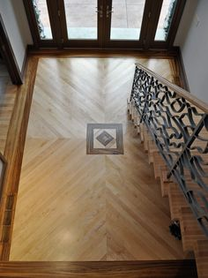 Foyer with Maple plank floor with zebra wood inlay