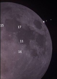 Left to right our Moon, Jupiter and her moons Io and Europa. I didn't take the picture but I did go back in and add the Apollo landing sites to the Moon. (The landing sites for Apollo 12 and 14 aren't visible in this picture)  --pc