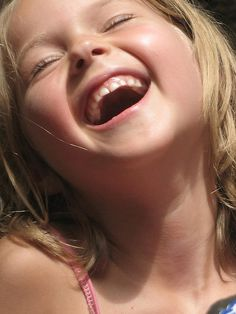 Emily's contagious laugh by Charlotte S., via Flickr