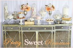 The best thing about this design is the mirrored credenza. Don't just use the obvious choice for a display, choose something with character to display pretty sweets and delicious treats!