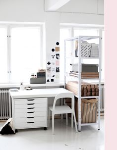 A dream studio setup: lots of window, white and places to store stuff.