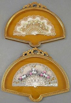 """Pair of Victorian mother-of-pearl and lace ladies fans, with hand-painted panels and gilt decoration, each mounted in an ornate French style frame. Overall frames- 20""""h.x24""""w.x2.25""""d."""