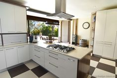 #Kitchen Idea of the Day: Modern white kitchen with checkerboard flooring.