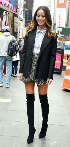 Jamie Chung in blazer and thigh-high boots