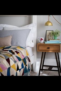 Funky bedroom. Love the side table.