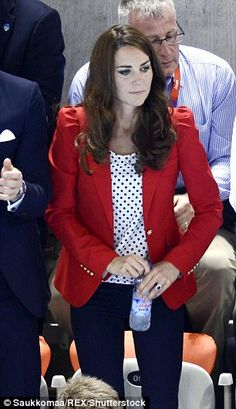 The royal wears a tailored red blazer white a polka dot shirt and skinny jeans for the 2012 Olympics