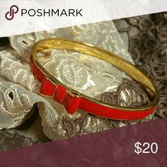Kate Spade Red Take A Bow Bangle Bracelet Adorable red and gold bow bangle bracelet by Kate Spade. Excellent condition, worn once. Dust bag included. Price is firm. kate spade Jewelry Bracelets