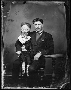 Man with his ventriloquist dummy circa 1870 - Photographer: William James Harding, Reference number: 1/4-006818-G, Wet collodion glass negative, Photographic Archive, Alexander Turnbull Library