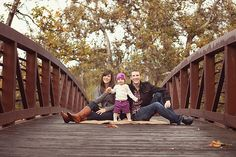 family on bridge -  excited about our holiday location pictures. This is a must. Love the distance  Marco Holiday pics 2013