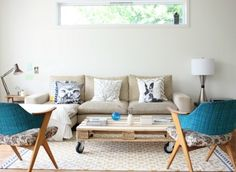 Mid Century inspired with Teal Accents. Love the owl pillow
