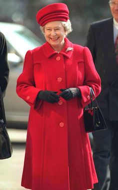 1996 from Queen Elizabeth II's Royal Style Through the Years  The Queen wore a red coat in Warsaw during her first visit to Poland, which also marked the first time in history that a British monarch visited the country.