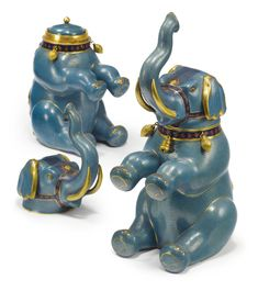 A PAIR OF CHINESE CLOISONNÉ ELEPHANT-FORM TEA CANNISTERS AND COVERS 20TH CENTURY height 11 1/2 in. 29.1 cm $7,500.00