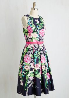 Gorgeous, graceful, and refined are just a few words to describe you in this floral dress. A demure A-line silhouette and pocketed, pleated skirt are emboldened with lavish blossoms that offer a lovely look. Topped off with a magenta belt to match the backing of its golden zipper, this frock has you looking as elegant as you feel.