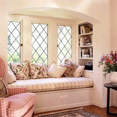 Wouldn't this reading nook be lovely for a guest room? If you added a drawer built into this window seat, you'd have storage for extra pillows, throws, messy magazines (and who doesn't have those?). I think it would be better without the arch, though.