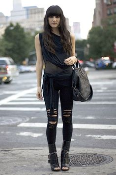 This outfit may have drawn inspiration from the 1990s. The ripped denim was very common during this time. The all black is also common with the grunge look. 3/19