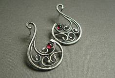 interesting tutorial on making these scroll wire work earrings including some soldering tips.