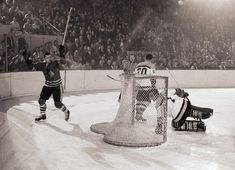 Stan Mikita celebrates after scoring a goal past Eddie Johnston during the Chicago Blackhawks game against the Boston Bruins on Jan. 23, 1964 at Boston Garden. The Hall of Fame player and Blackhawks...