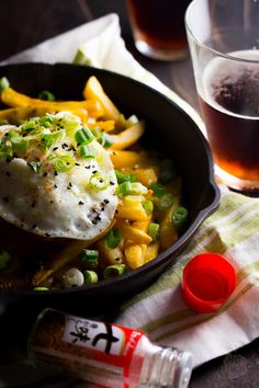"""Japanese curry fries. With a creamy egg over easy. And scallions. And some togaroshi for good measure. Alright... see ya next week then. Psych! On a side note, like.. how long has it been since you've had a good """"psych"""" in your life? What I'm here for, you guys. Erm.. anyway, it's hard to talk about"""