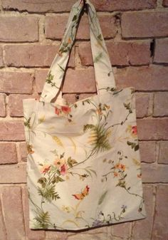 A handmade cotton print floral and butterfly design TOTE bag. Bag has shoulder handles and is not lined. Printed Tote Bags, Butterfly Design, Reusable Tote Bags, Floral, Pretty, Totes, Cotton, Handmade, Products