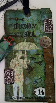 The Little Shabby Shed distressed altered tim Holtz inspired tag imagine vintage wander journey soul travel