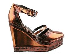 Just loving metallics for fall.....this would glam up any outfit......might even be comfy because it is a wedge.