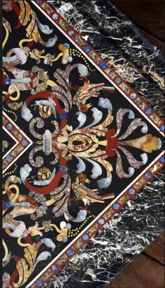 The pietre dure table top inlaid with semi-precious stones at Powis Castle, Powys