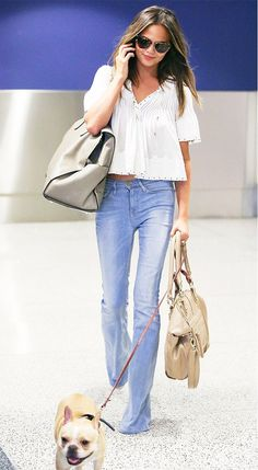 Chrissy Teigen kept it casually sleek in a white peasant blouse and light-wash bell-bottom jeans. // #Style