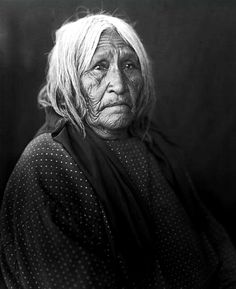 """Elderly Pima woman ca 1900-1920. - The Pima (or Akimel O'odham also spelled Akimel O'otham) live in an     area consisting of what is now central and southern Arizona. The Modern Reservation as of 1859 is called     the Gila River Indian Community. The long name, """"Akimel O'odham"""" means """"river people""""."""
