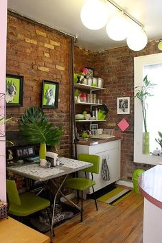 Small Apartment Design with Exposed Bricks Walls - kitchen furniture. Some cute ideas for other rooms, too.