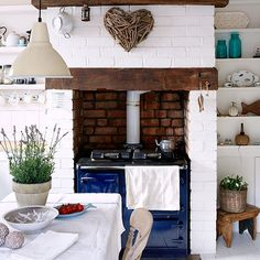 White painted brick kitchen Create a classic country kitchen by painting the walls and floorboards white. A range cooker in a bold shade of blue completes the look. Range cooker Esse Pendant light Ikea  Read more at http://www.housetohome.co.uk/kitchen/picture/white-painted-brick-kitchen#Blt1p21HmaPhsB91.99
