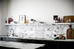 In this blog post, I am showing you more details of the stunning interior design by JeanCharles Tomas, which he has created in Saint-Sulpice near Paris #kitchendesign #marble #minimaldesign #interiordesign #blackandwhiteinterior #bathroomdesign #blackinterior #noir #apparatus #vitra #nuagevase Nuage #snoopylamp #floss #shelfi