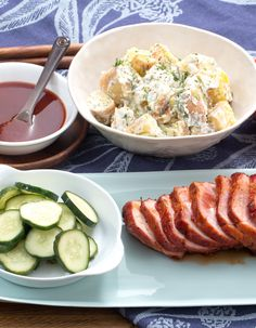 In this late-summer recipe, we're serving up roast pork with the works. Deliciously seasoned and coated with barbecue sauce, our pork comes with corn on the cob, creamy potato salad and crunchy, homemade dill pickles.