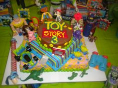toy story birthday cake | ... decorated it with all of our toy story toys to go with the theme