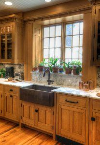 Ideas for how to update the look of a kitchen with oak cabinets using decor and accessories on the countertop by Crown Point