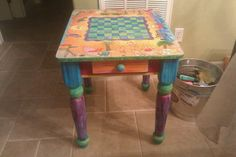 chess/checker board made with kids drawings wood burned and painted on table for school auction - love this idea.  I have a manufactured/purchased one I use for a coffee table on which many games have been played!