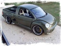 Lightning Bug...  Looks like a kitbashed model. There's no way a F-150 Lightning bed would mate up that nicely to a Beetle. But it looks neat all the same.