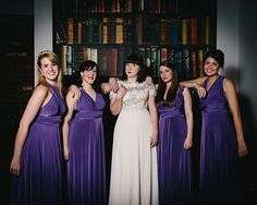 Bridesmaids wear purple wrap dresses | Photography by http://eclection-photography.com/