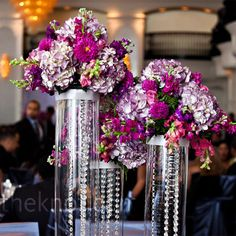 Hanging Crystal Centerpieces    Groups of cylinders filled with hanging crystals and topped with hydrangeas, celosia, stock and roses adorned half of the tables