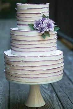 Three tiered buttercream wedding cake with lavender details @myweddingdotcom