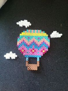 Perler Bead hot air balloon with clouds. By Allison Mohesky Easy Perler Bead Patterns, Melty Bead Patterns, Perler Bead Templates, Diy Perler Beads, Perler Bead Art, Pearler Beads, Beading Patterns, Loom Patterns, Loom Beading