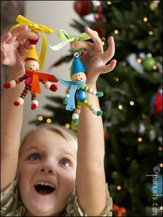 Beads, felt and ribbon--so simple even a kid can make an elf.  Although I can't say that from personal experience but I do plan to make one myself.