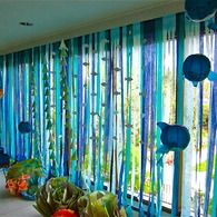 Under The Sea birthday party theme- decor could be underwater in the ocean - lets in light but sets watery mood